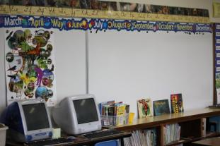 Classroom with computers and books