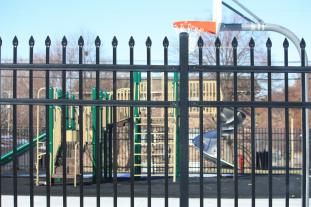 Fence and playground outside of a school
